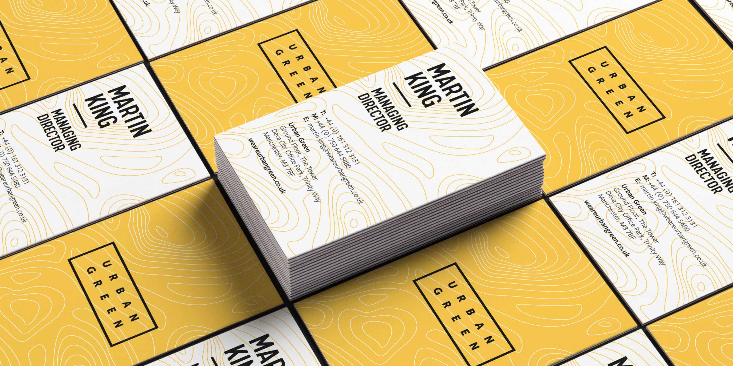 Business cards for Urban Green representing the rebrand for the organisation – bold black type against colourful sandy yellow contours representing the landscape as most of their work relates closely with landscape.